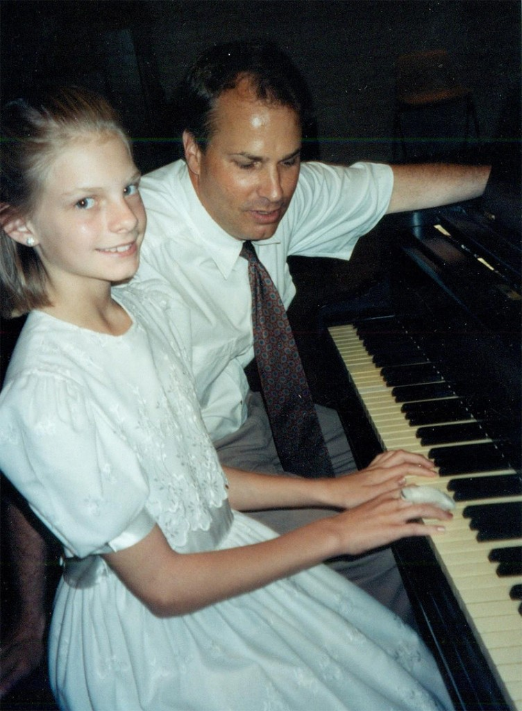 Thomas at the annual recital with a student.